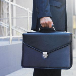 Midsection view of businessman holding briefcase
